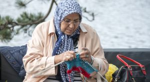Hellevoetsluis,Netherlands - June 29, 2013: woman knitting on a sofa outside on multiculture day in holland